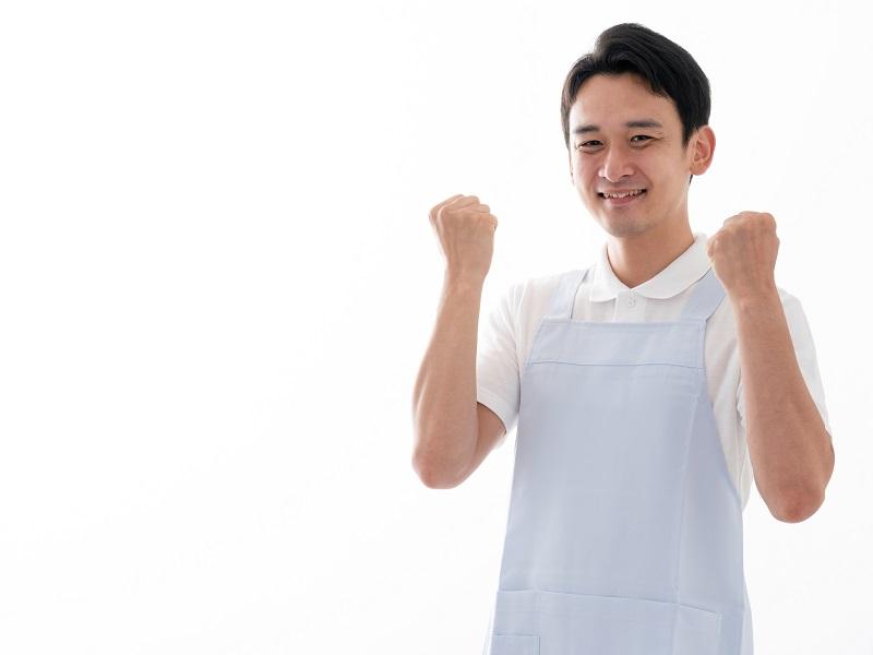 ガッツポーズをしている介護士のイメージ